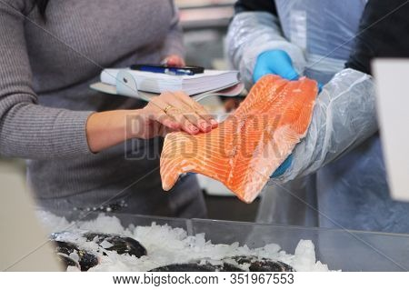 Selection Of Fish Products In The Hypermarket.photo Without Faces, Only Hands. Macro Photography In