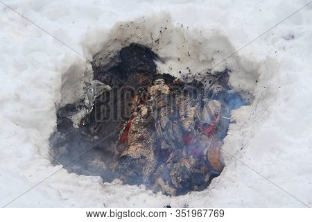 Burning Birch Firewood In A Snow Pit, Low Fire. Concept Of Winter Active Outdoor Recreation, Tourism