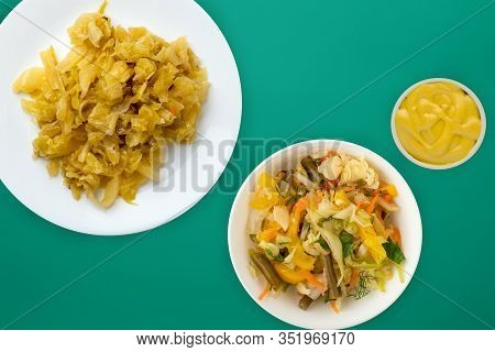Stewed Cabbage In A White Plate On A Green Background. Stewed Cabbage Top View. Healthy Eating. Vege
