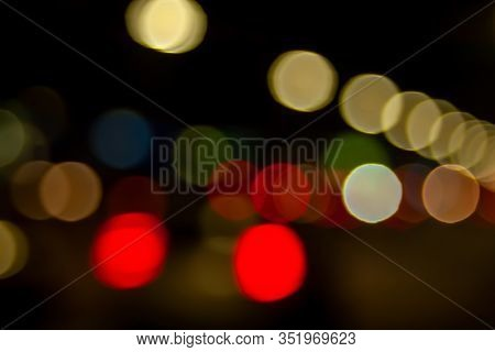 Boke Streets. Blurred Image Of The Light Of Street Lamps And Car Headlights At Night Riding In The C