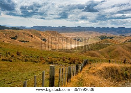 Dry Brown Burnt Rolling Hills On A Massive Sheep And Beef Farm In The Rural Agricultural Heartland O