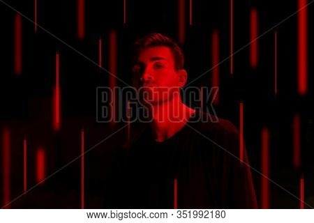 Sportsman basketball player at contrast red light