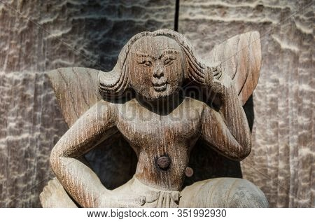 Mandalay, Myanmar - January 8, 2019: Detail of carvings from ancient teak Shwenandaw monastery or Golden palace