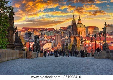 Prague, Czech Republic - April 20, 2019: Architecture of the Charles bridge in Prague at sunrise, Czech Republic