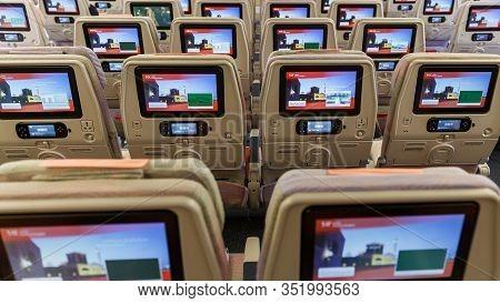 Dubai, Uae - February 13, 2020: Emirates New Economy Class Seats With Modern Multimedia System And L