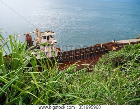 Image Of Old Rusty Ship On The Ocean Shore After Shipwreck