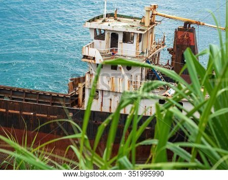 Photo Of Old Rusty Abandoned Ship Thrown On The Shore After Shipwreck
