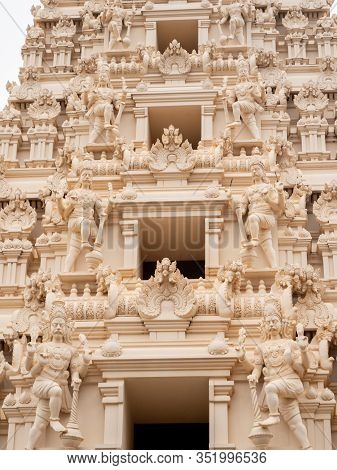 Closeup Photo Of Hindu Gods Carved On The Stone Rooftop Of Hindu Temple