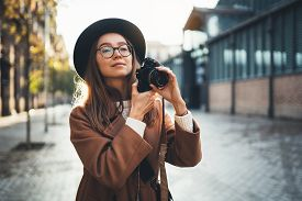 Hobby Photographer Concept. Outdoor Lifestyle Portrait Of Young Woman In Sun City Barcelona Europe W