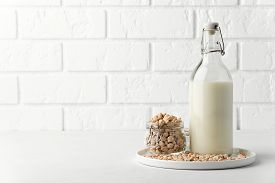 Dairy Products Without Milk. Chickpea Nut In A Glass Jar And Milk In A Bottle On A White Background.