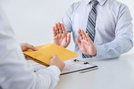 Businessman Refusing Receive Bribe Money In The Envelope Of Their Partner To Give Success The Deal C