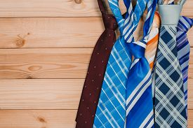 Accessories For Men. Colorful Ties On A Wooden Background. Concept Of Happy Father's Day Or Shoppig