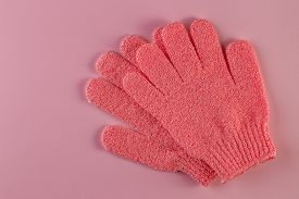 A Pair Of Pink Massage Gloves For Shower On Pink Background. Gloves For Use In The Shower For Massag