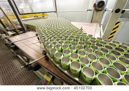 MOSCOW - MAY 16: Many open green cans move on conveyor in Ochakovo factory, on May 16, 2012 in Moscow, Russia. Ochakovo has breweries in several Russian cities - Moscow, Krasnodar, Tyumen, Penza.