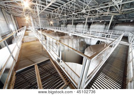 MOSCOW - MAY 31: Many metal cisterns in Ochakovo factory, on May 31, 2012 in Moscow, Russia. Moscow Ochakovo brewery produces 750 million liters of beer every year.