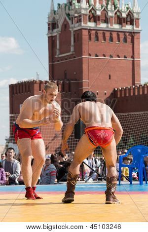 MOSCOW - MAY 26: The fighters are ready to Mongolian wrestling on VIII Forum Ready for Labor and Defense on May 26, 2012 in Red Square, Moscow, Russia.