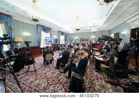 MOSCOW - APRIL 24: Newspapermen and cameramen work on Enlarged meeting of Council in Grand Kremlin Palace on April 24, 2012 in Moscow, Russia.