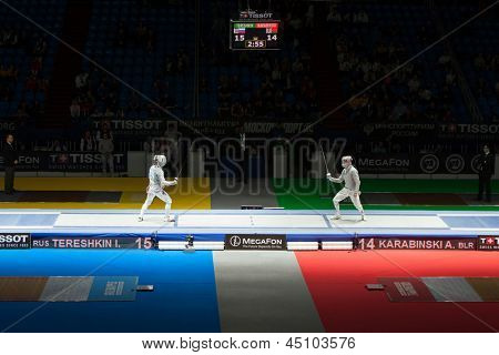 MOSCOW - APR 6: Tereshkin and Karabinski compete on championship of world in fencing among juniors and cadets, in Sports complex, on April 6, 2012 in Moscow, Russia