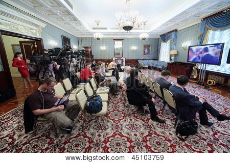 MOSCOW - APRIL 24: Pressmans sit in front of TV on Enlarged meeting of Council in Stuffed hall of guest annexe in Grand Kremlin Palace on April 24, 2012 in Moscow, Russia.