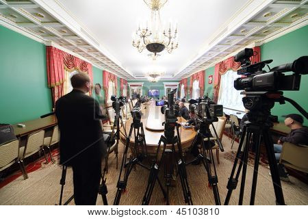 MOSCOW - APRIL 24: Video cameras and newspapermans sit in front of TV on Enlarged meeting of Council in Grand Kremlin Palace on April 24, 2012 in Moscow, Russia.