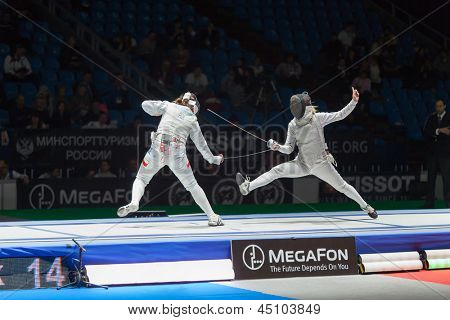 MOSCOW - APR 6: Midst of battle athletes on championship of world in fencing among juniors and cadets, in Sports Olympic complex, on April 6, 2012 in Moscow, Russia