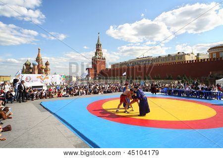 MOSCOW - MAY 26: The young fighters are locked in Mongolian wrestling on VIII Forum Ready for Labor and Defense on May 26, 2012 in Red Square, Moscow, Russia.