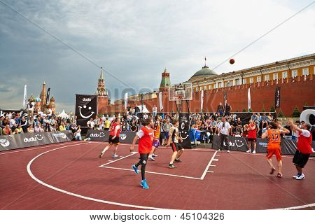 MOSCOW - MAY 27: People watch basketball game during Dudu Streetbasket fest on Red Square, May 27, 2012, Moscow, Russia. Dudu Streetbasket fest takes place within 8th sports forum GTO.