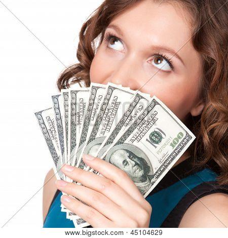Portrait Of Pretty Young Woman Holding A Fan Of Dollar Bills