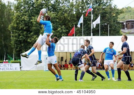 MOSCOW - JUN 30: Athlete raised another athlete at second stage of European championship on rugby-7 in sports complex Luzhniki, Jun 30, 2012, Moscow, Russia.