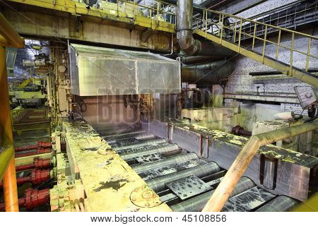 Pressing machine works in production shop of rolling mill