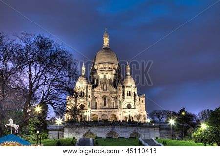 PARIS APRIL 18: Sacre Coeur Basilica at night on April 18, 2013 in Paris, France. Sacre Coeur is one of the most important basilica of Paris