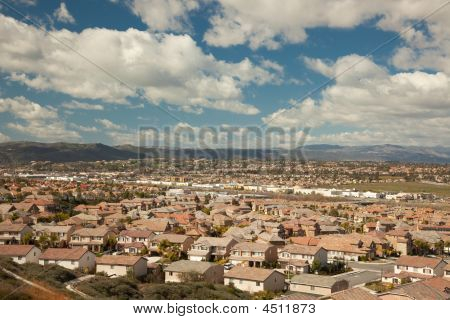 Contemporary Neighborhood And Majestic Clouds