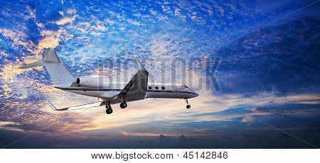 Small Private Jet In A Sunset Sky