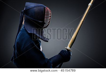 Profile of kendo fighter with bokuto. Japanese martial art of sword fighting