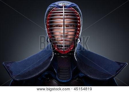 Portrait of kendoka in traditional armor