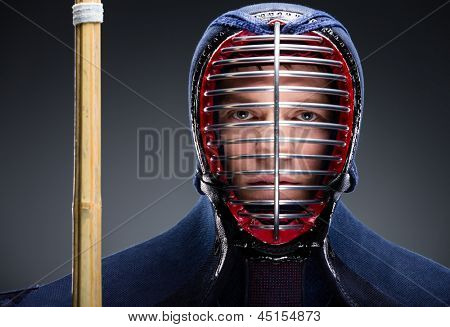 Portrait of kendo fighter with shinai. Concept of Japanese martial arts