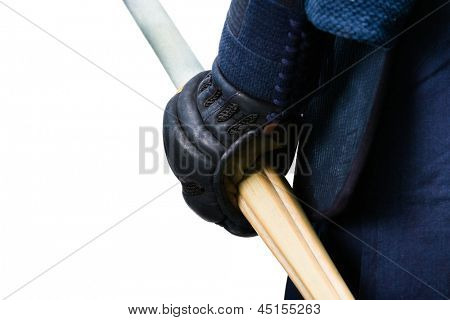 Close up of hand in kote with bokuto, isolated on white. Japanese martial art of sword fighting