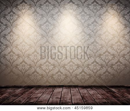 grunge interior room with baroque wallpaper and spots.