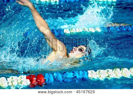 Swimmer in waterpool swim backstroke style