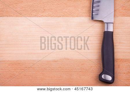 Sharp knife on cutting board
