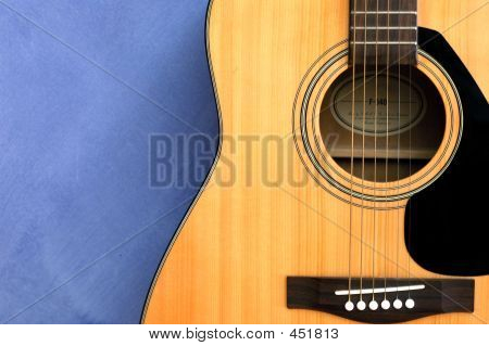 Acoustic Guitar In Blue Background