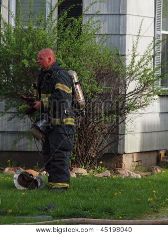 Fireman Rests After House Fire