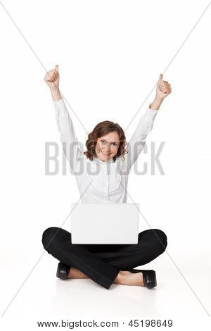 Portrait Of A Pretty Young Woman Sitting In Front Of Her Laptop