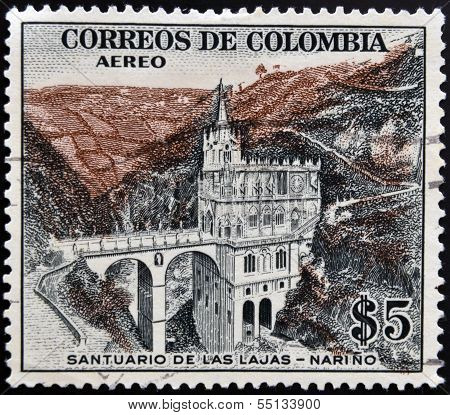 A stamp printed in Colombia shows Santuario de las Lajas Narino