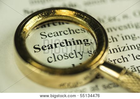 Searching Concept With Closeup Golden Magnifying Glass