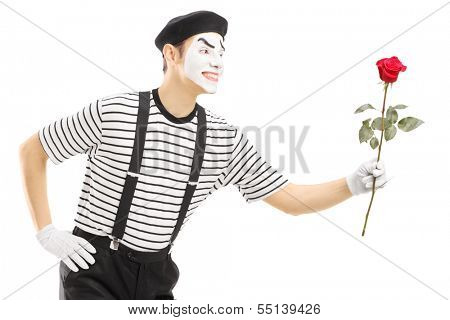 Male mime artist giving a rose flower isolated on white background