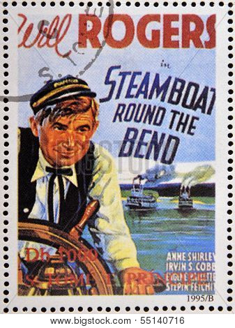 A stamp printed in Sao Tome shows movie poster Steamboat Round the Bend