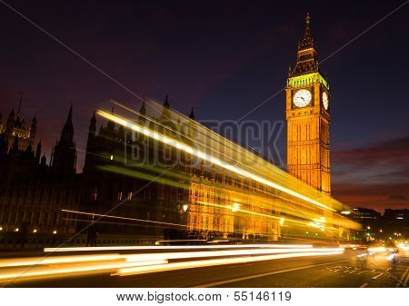 Big Ben and a light trail at dusk