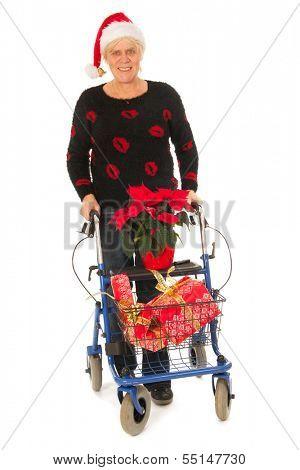 Senior woman going to Christmas celebration isolated over white background