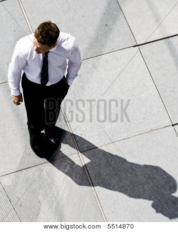 Corporate Man On The Sidewalk